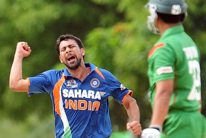India cricketer Praveen Kumar celebrates after dismissing Bangladeshi cricketer Tamim Iqbal during the second ODI of the Asia Cup, played at the Rangiri Dambulla International Cricket stadium in Dambulla. (AFP Photo)