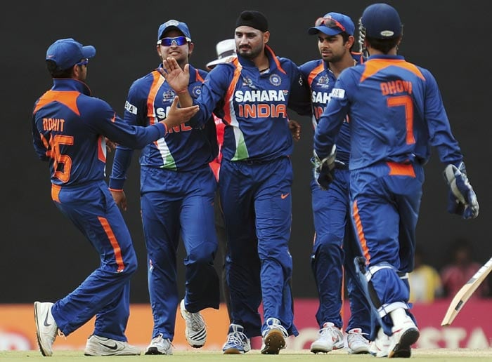 Indian cricketer Harbhajan Singh and teammates celebrate the dismissal of unseen Bangladeshi cricket captain Shakib Al Hasan during the second ODI of the Asia Cup, played at the Rangiri Dambulla International Cricket stadium in Dambulla. (AFP Photo)