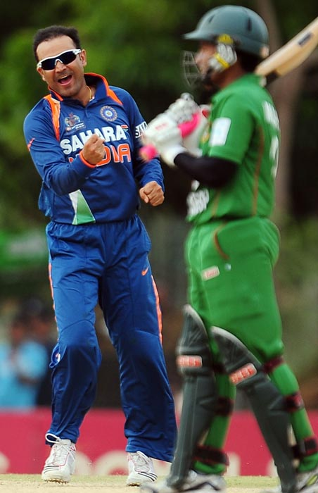 Indian cricketer Virender Sehwag celebrates the dismissal of Bangladeshi cricketer Mushfiqur Rahim during the second ODI of the Asia Cup, played at the Rangiri Dambulla International Cricket stadium in Dambulla. (AFP Photo)