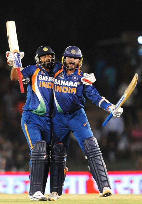 India cricketer Harbhajan Singh and teammate Praveen Kumar celebrate India's victory in the fourth ODI of the Asia Cup between India and Pakistan at the Rangiri Dambulla International Cricket stadium in Dambulla. (AFP Photo)