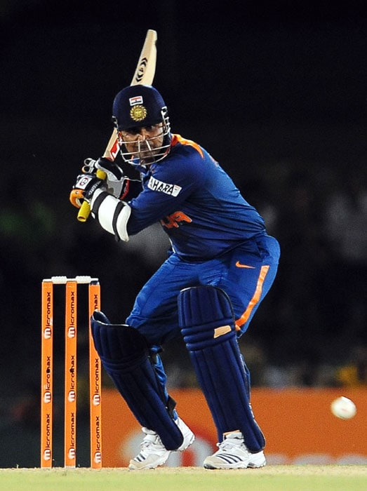 Virender Sehwag plays a shot during the fourth ODI of the Asia Cup between India and Pakistan at the Rangiri Dambulla International Cricket stadium in Dambulla. (AFP Photo)