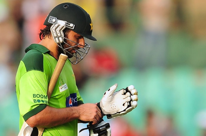 Shahid Afridi looks on after being dismissed during the fourth ODI of the Asia Cup between India and Pakistan at the Rangiri Dambulla International Cricket stadium in Dambulla. (AFP Photo)