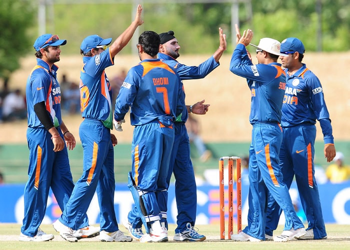 Indian cricketers congratulate Harbhajan Singh after his dismissed Imran Farhat during the fourth ODI of the Asia Cup between India and Pakistan at the Rangiri Dambulla International Cricket stadium in Dambulla. (AFP Photo)