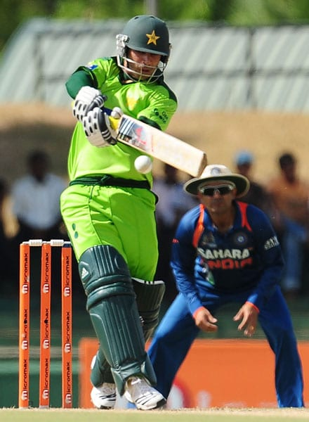Salman Butt is watched by Virender Sehwag as he plays a shot during the fourth ODI of the Asia Cup between India and Pakistan at the Rangiri Dambulla International Cricket stadium in Dambulla. (AFP Photo)