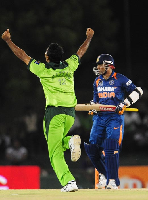 Pakistan cricketer Abdul Razzaq celebrates after the dismissal of Indian cricketer Virender Sehwag during the fourth ODI of the Asia Cup between India and Pakistan at the Rangiri Dambulla International Cricket stadium in Dambulla. (AFP Photo)