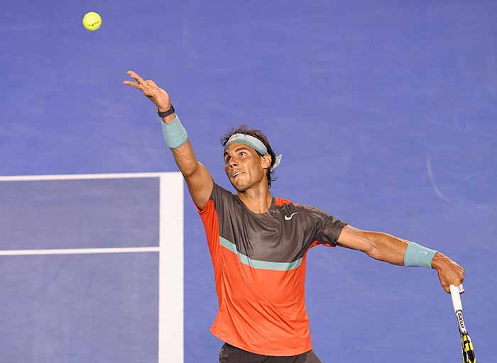 Top seed Rafael Nadal eased past Thanasi Kokkinakis and was kept on the Rod Laver Arena for just one hour and 53 minutes.