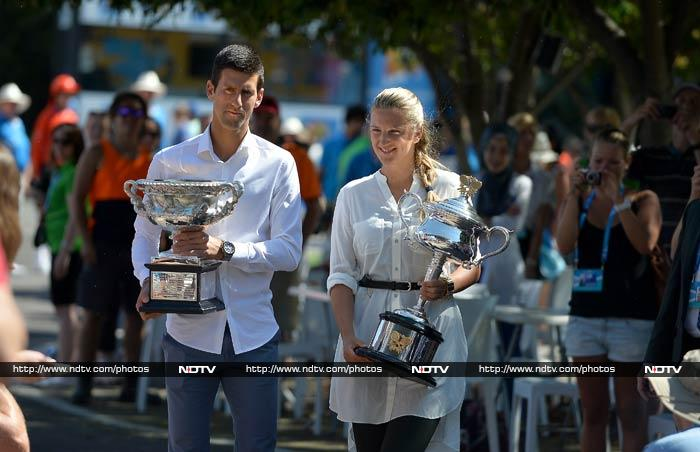 Novak Djokovic and Victoria Azarenka came out with their Australian Open titles in Melbourne. <br><br>Champions from last year, the two smiled but looked in no mood to part with their respective trophies this year. <br><br>Images courtesy: AFP and AP