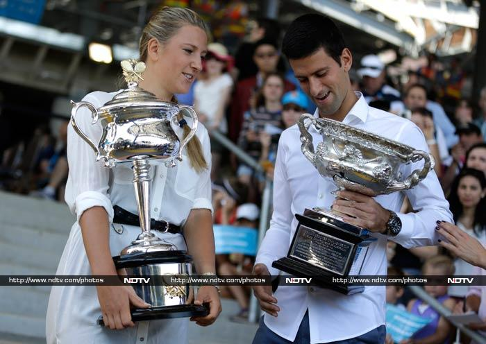 """""""Yours has a blemish!""""<br><br> Azarenka and Djokovic seen here in what appears to be a light-hearted conversation."""
