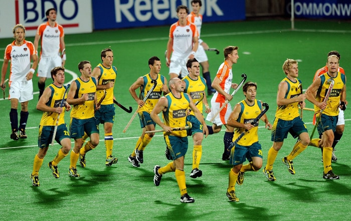 Australian Hockey players celebrate their second goal against Netherlands during their World Cup 2010 Semi-Final match at the Major Dhyan Chand Stadium in New Delhi. (AFP Photo)
