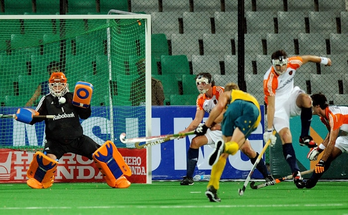 Australian Hockey player Luke Doerner scores a goal against the Netherlands during their World Cup 2010 semifinal match at the Major Dhyan Chand Stadium in New Delhi. (AFP Photo)