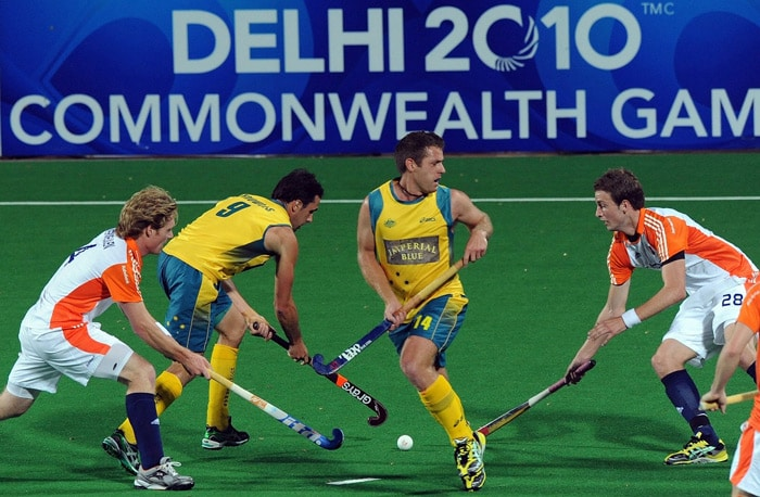Australian hockey players Mark Knowles (2nd L) and Grant Schubert (2nd R) in action against the Netherlands' Klaas Vermeulen (L) and Billy Bakker (R) during their World Cup 2010 semifinal match at the Major Dhyan Chand Stadium in New Delhi. (AFP Photo)