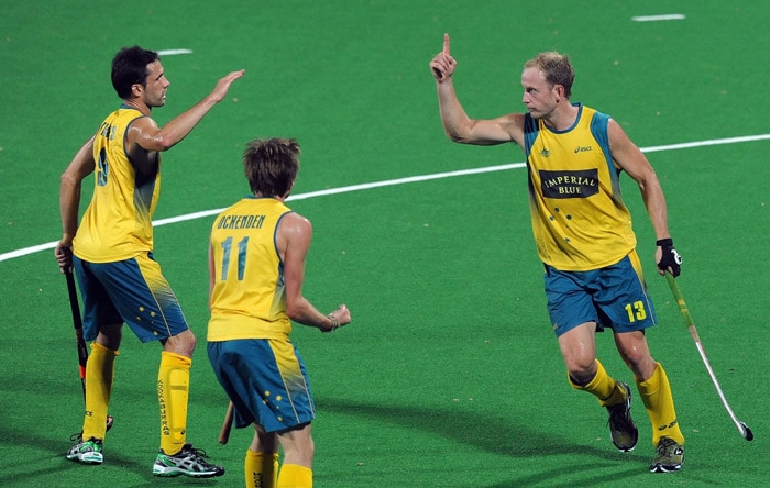 Australian hockey player Luke Doerner (R) celebrates a goal against the Netherlands with teammates during their World Cup 2010 semifinal match at the Major Dhyan Chand Stadium in New Delhi. (AFP Photo)