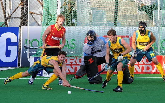 Australian hockey player Graeme Begbie stops an attempt at goal by a Spain player during their World Cup 2010 match at the Major Dhyan Chand Stadium in New Delhi. (AFP Photo)