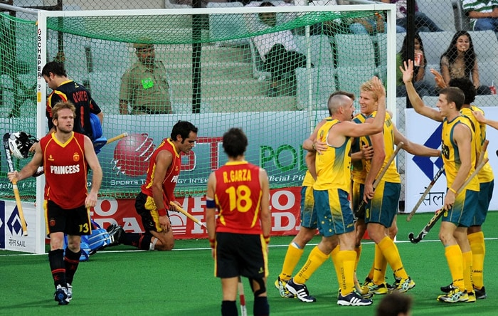 Australian Hockey players celebrate their second goal against Spain during their World Cup 2010 match at the Major Dhyan Chand Stadium in New Delhi. (AFP Photo)