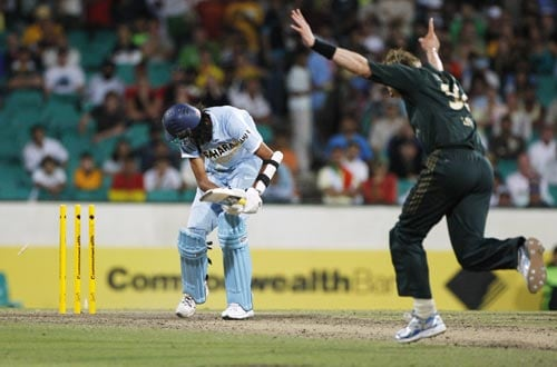 Brett Lee right, celebrates after dismissing Indian batsman Ishant Sharma left during their one-day international at the Sydney Cricket Ground on Sunday, February 24, 2008.