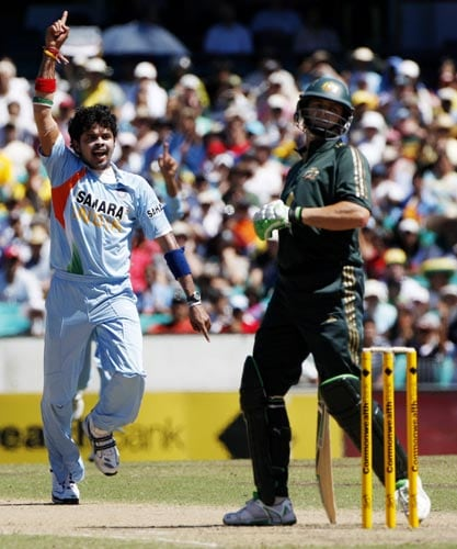 Sreesanth left, celebrates after dismissing Adam Gilchrist, right, during their one-day international at the Sydney Cricket Ground on Sunday, February 24, 2008.