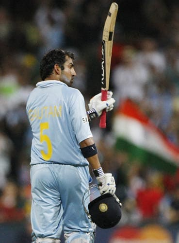 Gautam Gambhir shows his bat to his teammates as he celebrates his century their one-day international against Australia at the Sydney Cricket Ground on Sunday, February 24, 2008.