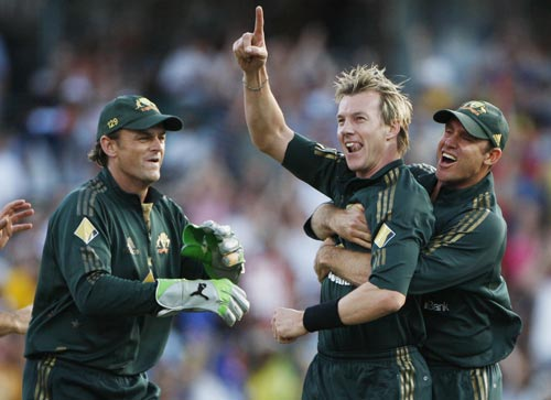 Brett Lee is embraced by teammate Matthew Hayden right, as Adam Gilchrist left, looks on after dismissing Sachin Tendulkar during their one-day international at the Sydney Cricket Ground on Sunday, February 24, 2008.