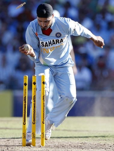 Harbhajan Singh takes the bails off to run out Brett Lee for no score during their one-day international at the Sydney Cricket Ground on Sunday, February 24, 2008.