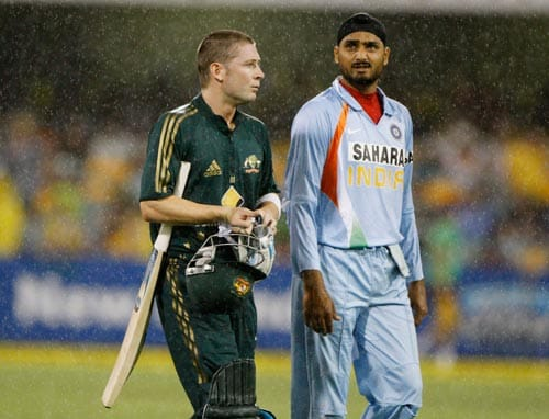 Michael Clarke, left, walks off with Harbhajan Singh after their One-Day cricket international was abandoned due to rain in Brisbane on Sunday, February 03, 2008.