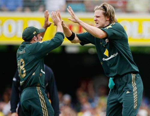 Australian bowler Nathan Bracken, right, celebrates with team-mate Michael Hussey, left after dismissing Indian batsman Virender Sewhag during their One-Day cricket international against Australia in Brisbane on Sunday, February 03, 2008.