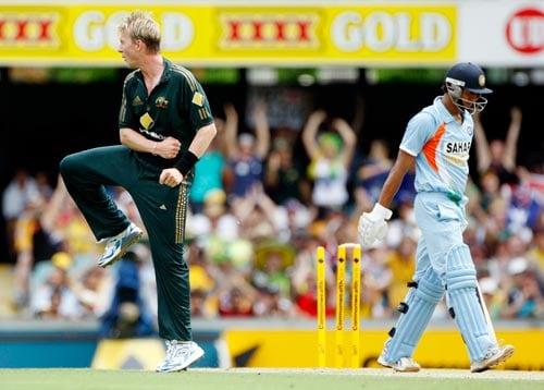 Manoj Tiwary, right, is bowled by Brett Lee during their One-Day cricket international in Brisbane on Sunday, February 03, 2008.
