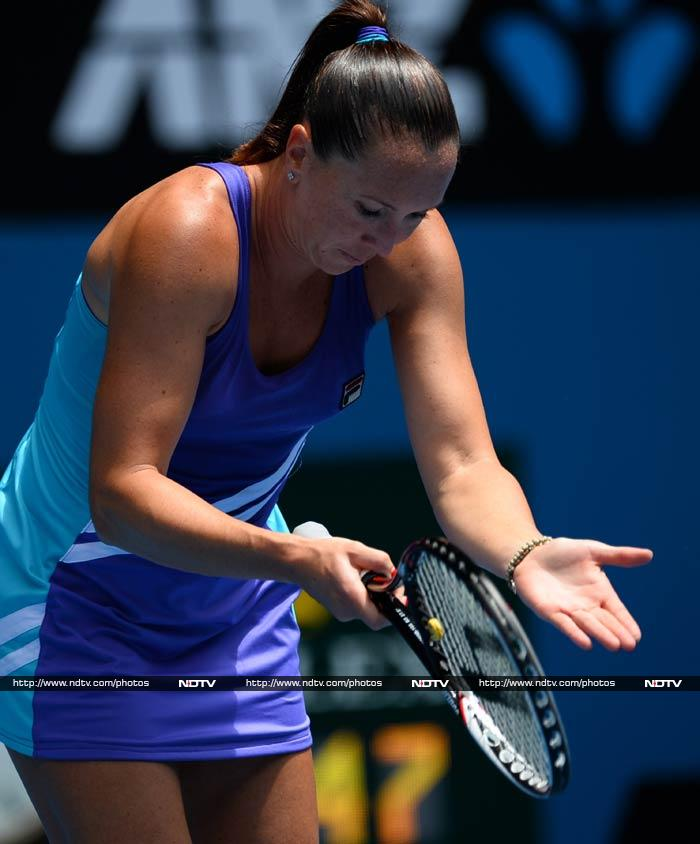 Jelena Jankovic - seeded eight - gestures to indicate, perhaps, that she has already gifted her 4th round match to Simona Halep of Romania.
