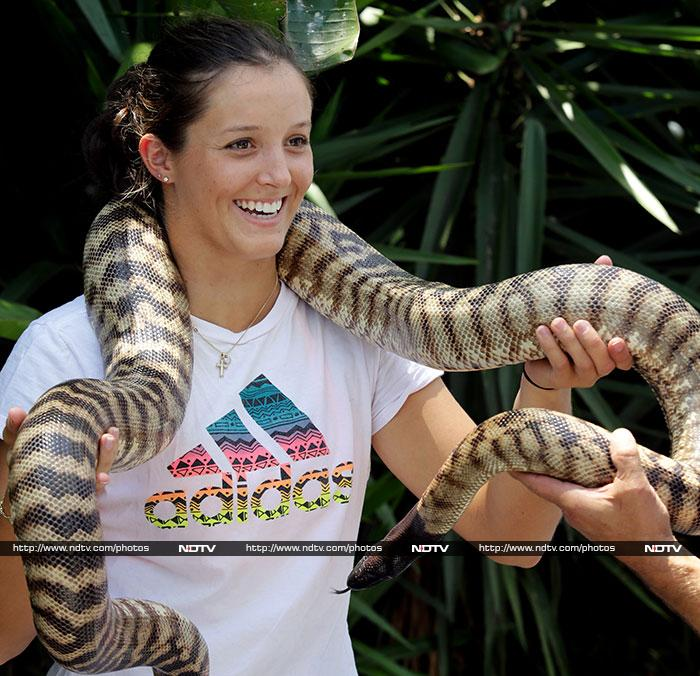 The 19-year-old Laura suffered a wrist injury and had to pull out of Hobart International. <br><br>Her wrists seem quite fine here though we don't know about her heart as she wraps an Australian python around her.