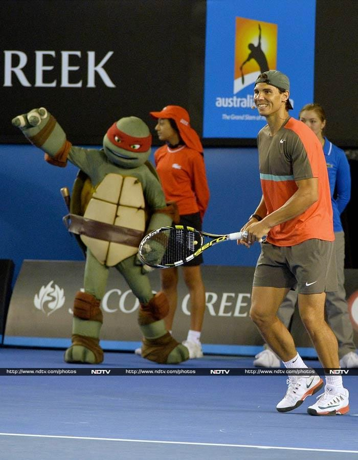 Speaking of fans, Rafael Nadal has a huge following too. He is seen here being cheered by a member of the Teenage Mutant Ninja Turtles.