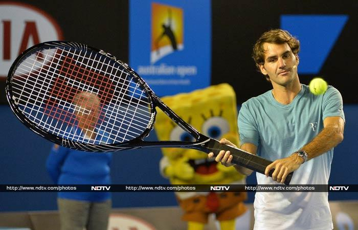 Federer is seen here in front of someone who appears to be his biggest fan - Sponge Bob!