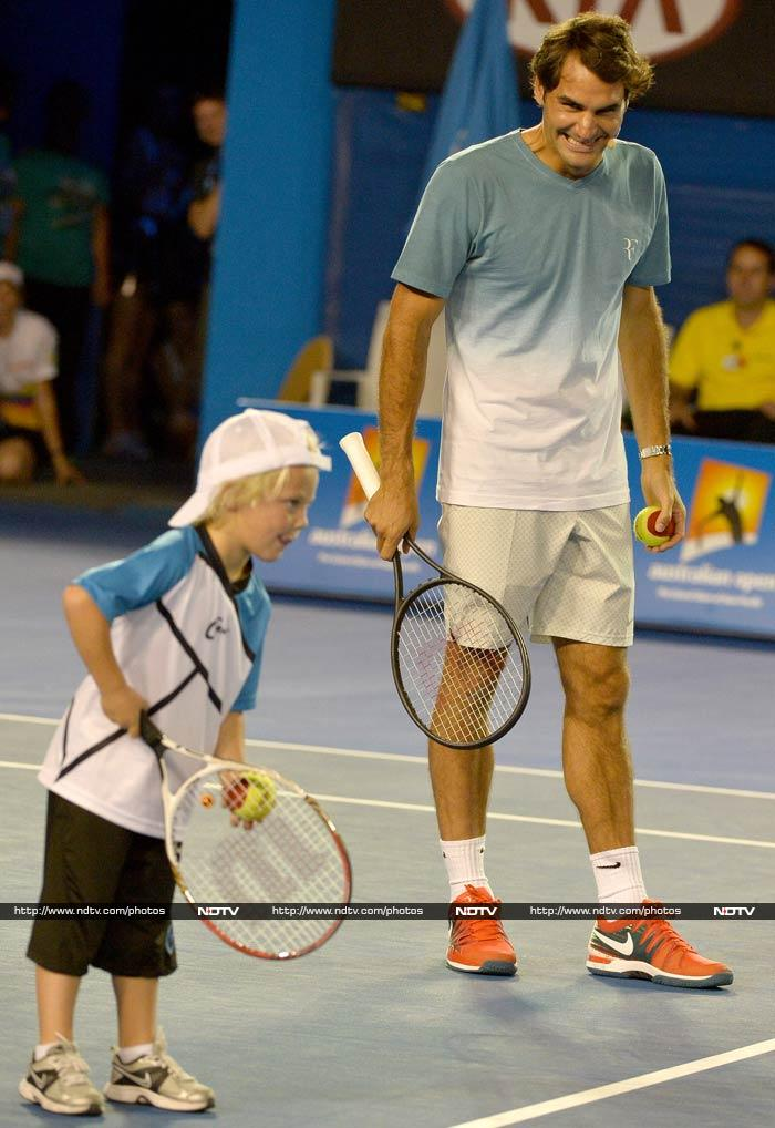 Top stars are not the only ones having all the fun. <br><br> Federer is seen here with Lleyton Hewitt's son.