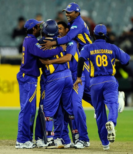 Sri Lankan players celebrate after defeating Australia in their one-day international cricket match at the Melbourne Cricket Ground on Friday, February 29, 2008.