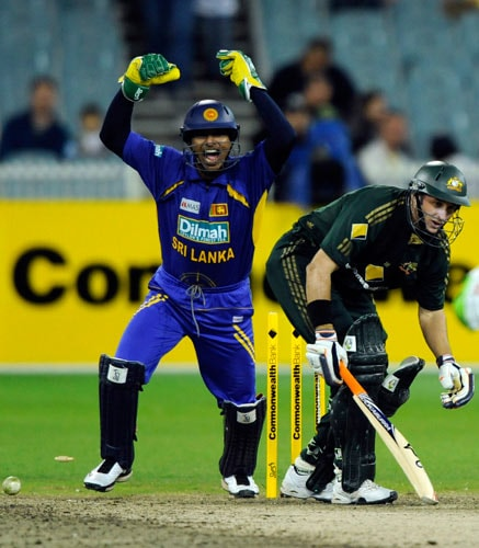 Kumar Sangakkara, left, from Sri Lanka celebrates after teammate Chamara Kapugedera bowls Michael Hussey out during one-day international cricket match against Australia at the Melbourne Cricket Ground on Friday, February 29, 2008.