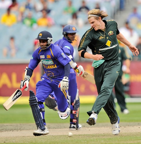 Nathan Bracken, right, from Australia attempts to run out Sanath Jayasuriya from Sri Lanka during their one day international match at the Melbourne Cricket Ground on Friday, February 29, 2008.
