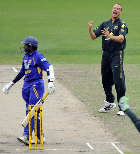 Stuart Clark, right, from Australia celebrates the wicket of Dilruwan Perera during their one-day international cricket match against India at the Melbourne Cricket Ground on Friday, February 22, 2008.