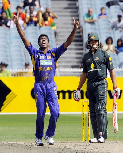 Farveez Maharoof, left, from Sri Lanka celebrates the wicket of Andrew Symonds during the one-day international cricket match against Australia at the Melbourne Cricket Ground on Friday, February 22, 2008.