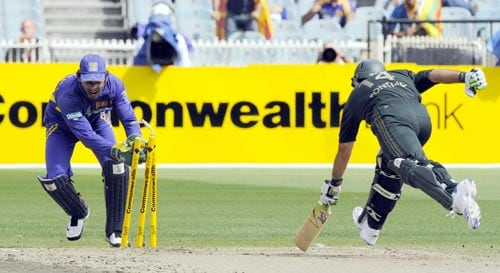 Sri Lankan keeper Kumar Sangakkara, left, runs out Ricky Ponting during the one-day international cricket match against Australia at the Melbourne Cricket Ground on Friday, February 22, 2008.