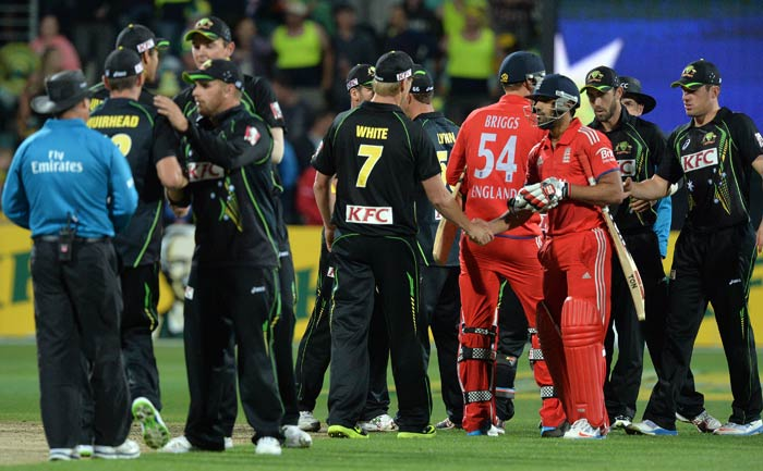 Nathan Coulter-Nile's four for 30 kept England at bay and secured a 13-run victory for Australia in the first T20.