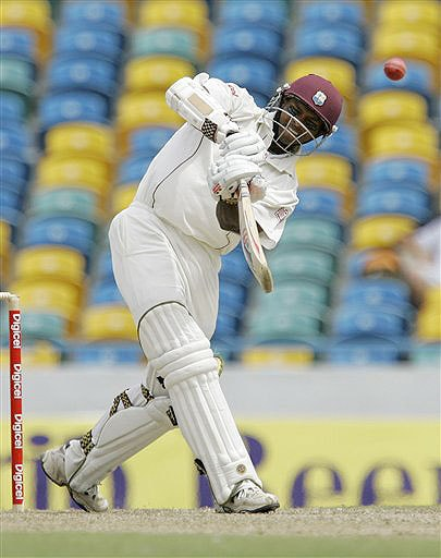 West Indies' Shivnarine Chanderpaul plays a shot for four runs on the second day of the third and final Test against Australia at Kensington Oval in Bridgetown, Barbados on June 13, 2008.