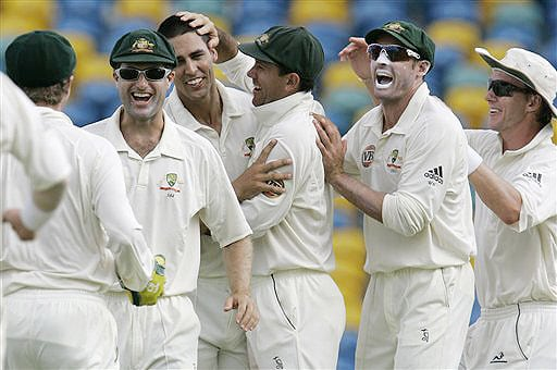 Australia's left-arm pacer Mitchell Johnson, captain Ricky Ponting, Michael Hussey, Brett Lee, Simon Katich and wicketkeeper Brad Haddin celebrate the wicket of West Indies' Dwayne Bravo on the second day of their third and final Test at Kensington Oval in Bridgetown, Barbados on June 13, 2008.