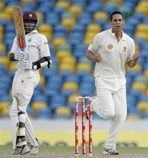 Australia's left-arm pacer Mitchell Johnson celebrates the dismissal of West Indies' Fidel Edwards who was caught out by captain Ricky Ponting for one run, to end the first innings on the second day of their third and final Test at Kensington Oval in Bridgetown, Barbados on June 13, 2008.