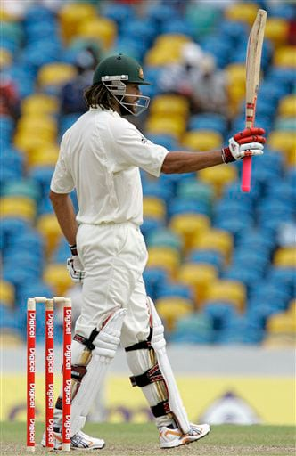 Andrew Symonds raises his bat to celebrate a half-century on the opening day of the third and final cricket Test match against West Indies in Bridgetown on Thursday, June 12, 2008.