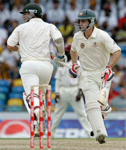 Australia's openers Simon Katich, right, and Phil Jaques run between wickets on the opening day of the third and final cricket Test match against the West Indies in Bridgetown on Thursday, June 12, 2008.