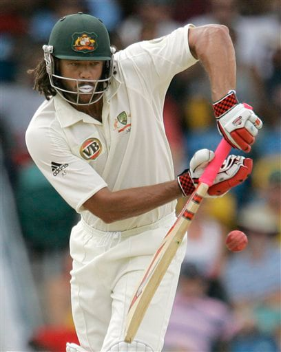 Australia's batsman Andrew Symonds drives off the bowling of West Indies' Fidel Edwards on the opening day of their third and final cricket Test match in Bridgetown on Thursday, June 12, 2008.