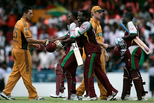 West Indies' Xavier Marshall, center, embraces teammate Dwayne Bravo as he's congratulated by Australia's Mitchell Johnson, and teammate Andre Fletcher, far right, shake hands with Australia's Cameron White, after the West Indies' beat Australia by six wickets in the international Twenty20 cricket match at Kensington Oval in Bridgetown on Friday, June 20, 2008.
