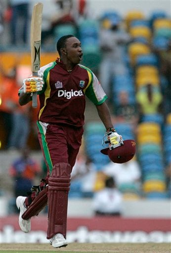 West Indies' all-rounder Dwayne Bravo reacts after hitting a six off Australia's Shane Watson to win the international Twenty20 cricket match at Kensington Oval in Bridgetown on Friday, June 20, 2008. The West Indies won by seven wickets in the 11-overs-per-side reduced match due to rain.