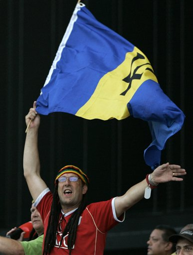 A West Indies' cricket fan cheers while waving a Barbados' flag during the international Twenty20 cricket match against Australia at Kensington Oval in Bridgetown on Friday, June 20, 2008. The West Indies won by seven wickets in the 11-overs-per-side reduced match due to rain.