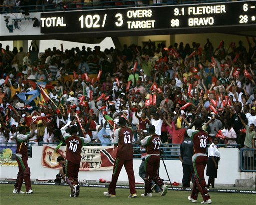 West Indies' players, from left, Dwayne Bravo,Denesh Ramdin, Sulieman Benn, Andre Fletcher and Darren Sammy greet their fans after beating Australia by six wickets in the international Twenty20 cricket match at Kensington Oval in Bridgetown on Friday, June 20, 2008.