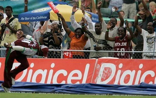 West Indies' cricket fans celebrates after player Xavier Marshall, left, took the catch to dismiss Australia's batsman Shaun Marsh for 29 runs during their international Twenty20 cricket match at Kensington Oval in Bridgetown on Friday, June 20, 2008.