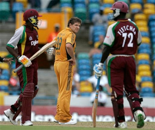 Australia's bowler James Hopes, center, reacts after West Indies' batsman Dwayne Bravo, left, hit a four off his delivery, as partner Andre Fletcher looks on, during their international Twenty20 cricket match at Kensington Oval in Bridgetown on Friday, June 20, 2008. The West Indies won by seven wickets in the 11-overs-per-side reduced match due to rain.